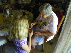 Mom teaching great-granddaughter Mercedez
