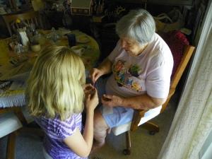 Mom teaching great-granddaughter Mercedez