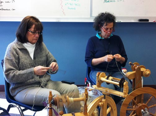 The knitters have a timer (on left leg) to monitor their speed.