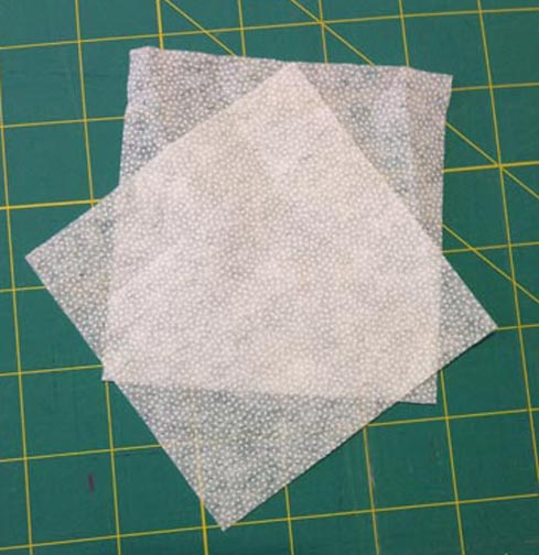 "Two 4"" Squares of iron-on interfacing"