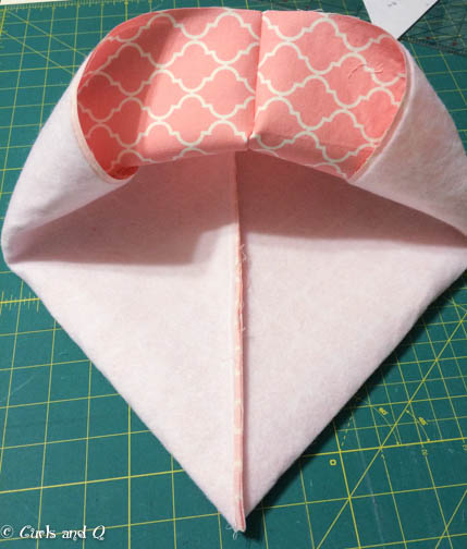 Squish the corner down to meet the bottom center. To form a 90 degree angle