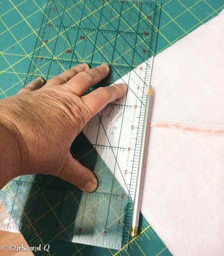 Use a ruler to draw a line onto the fabric